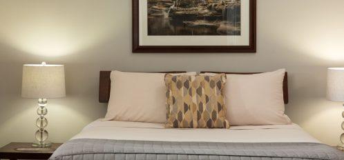 Deluxe Full Service Suite Bedroom