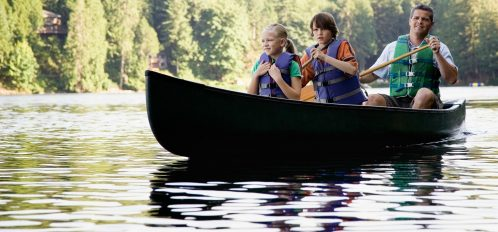 a family of three Canoeing the Delaware River
