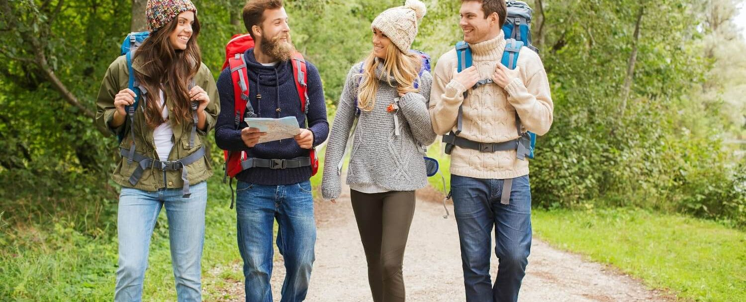 a group of four young adults enjoying hiking in the poconos mountains